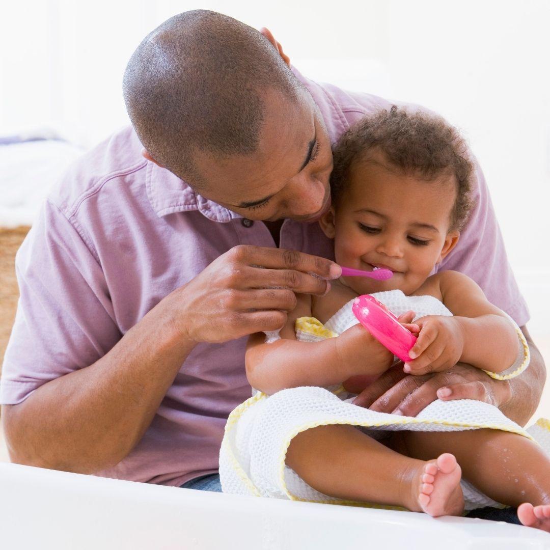 Oral Health Tips - brush baby teeth